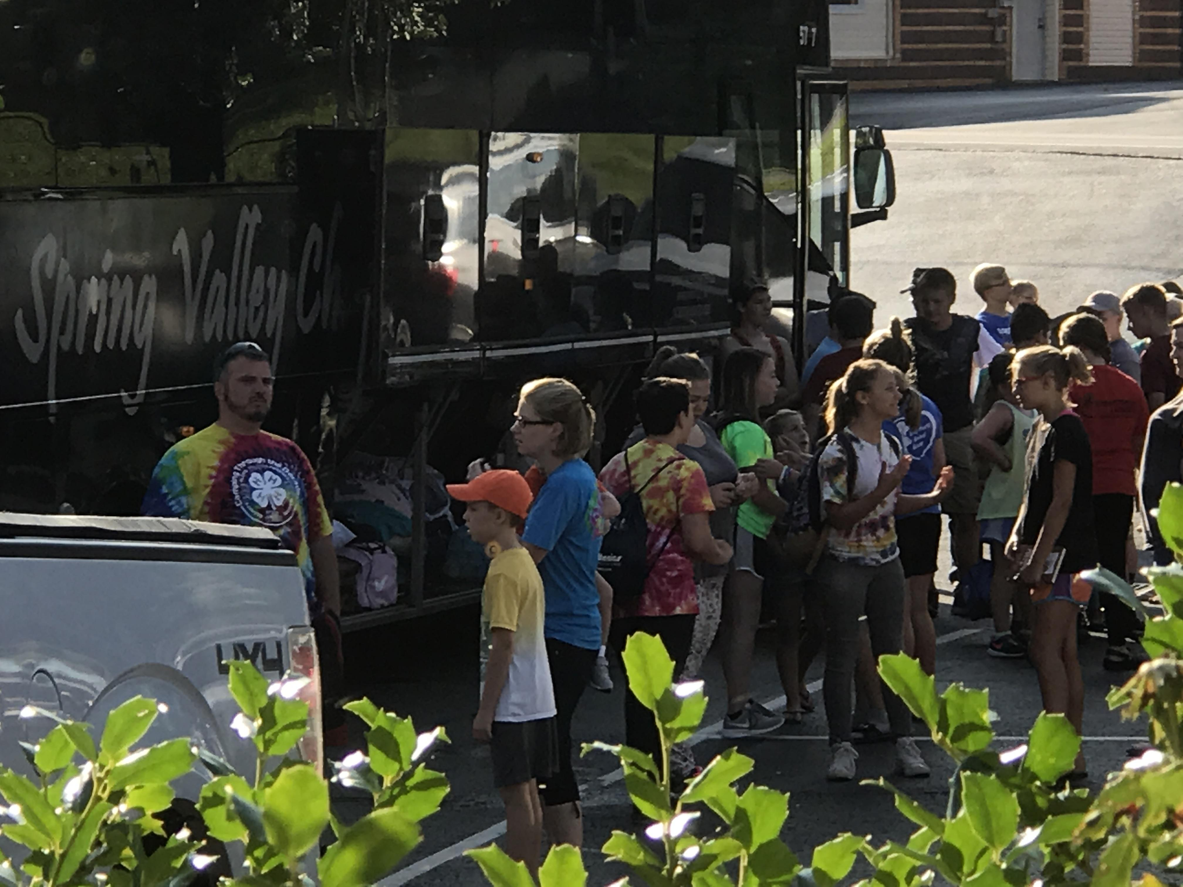 4-H campers are ready to board the bus.
